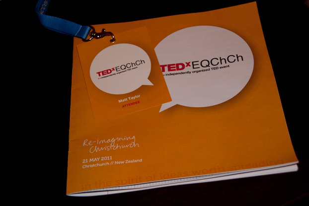 The TEDxEQChCh name tag and programme looking very flash.